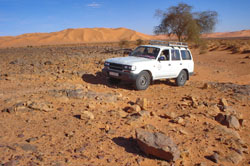 Toyota Landcruiser crossing the rocky Libyan desert