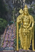 Pilgrims climb past the 43m high statue of Lord Murugan