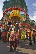 Thaipusam devotees carry their elaborate Kavadi burdens