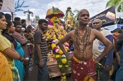 Thaipusam devotee with skewer through his cheeks