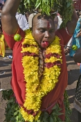 A skewer pierces the cheeks and tounge of this Thaipusam pilgrim