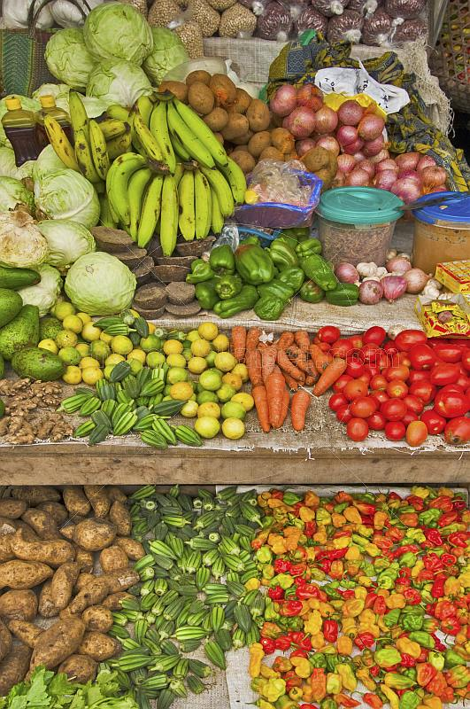 Assorted fruit and vegetables for sale on market stall.
