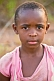 Young Gabonese girl with short hair in a light purple shirt.