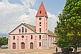 Image of The pink-painted Church of the Catholic Mission.