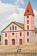 Image of Two boys walk to see the pink-painted Church of the Catholic Mission.