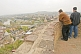 Image of Two men gaze at the view over central Tbilisi from the ramparts of the Narikala Fortress.