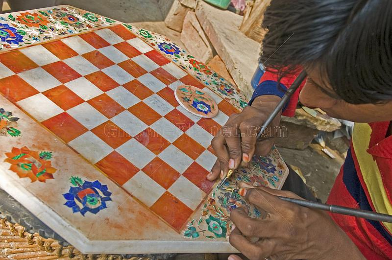 Young craftsman creating a chess board from inlaid-marble, or Pietra-Dura.