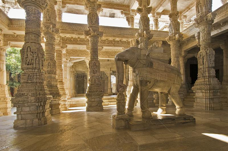 Intricately carved white marble elephant and interior of the Adinatha Temple at Ranakpur.