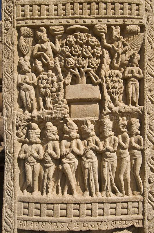Detail of carving on the West Gateway of the Main Stupa, which portrays the seven incarnations of the Buddha.