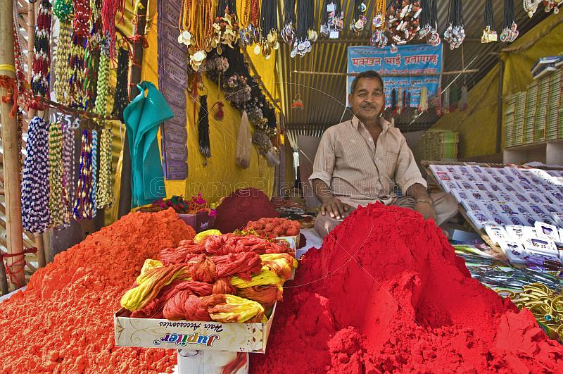 Festival stall sells colored powder known as Sindoor or Goolal or Kum-kum powder.
