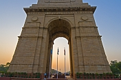 Sunset through 42m high Lutyens-designed India Gate war memorial.