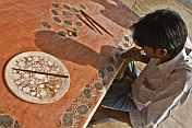 Young craftsman works on a Pietra-Dura inlaid-marble panel.
