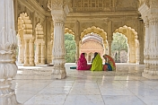 Three Indian ladies sit in the Cenotaph of Maharaja Bakhtawar Singh.