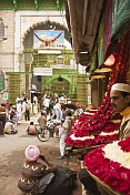 Rose-blossom sellers wait outside the Dargah of Khwaja Muinuddin Chisti.
