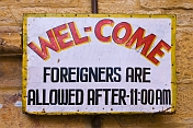 Welcome sign - Foreigners Are Allowed After 11:00 AM.