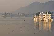 Late evening sunlight shines off the Lake Palace Hotel on Lake Pichola.