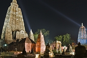 Twilight view of small stupas and shrines in front of the main Mahabodhi Temple.