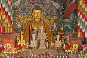 Buddhist statue in colorful robes at the Bhutanese Temple.