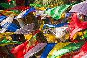Colorful Buddhist prayer flags dance in the wind at the Mahakala Temple on Observatory Hill.
