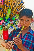 A whistle-seller demonstrates his wares on Leela Beach.