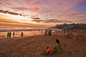 Indian bathers on Hawaa Beach watch the last rays of sunset.