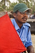 Indian lifeguard with red flag.