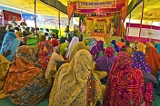 Village Women In Saris Watch Religious Play