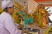 Two Girls Perform Hindu Religious Dance Accompanied By Organ