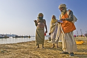 Three Hindu Holy Men At The Ganges Yamuna Sangam