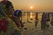 Men And Women Prepare To Bathe In Ganges River At Dawn