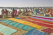 Colorful Saris Laid To Dry Next To Ganges River