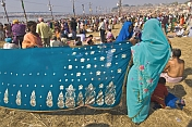 Woman Holds Sari Out To Dry In Warm Sunshine At Sangam