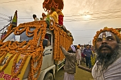 Sadu and truck decorated with marigold flowers for Basant Panchami Snana procession.