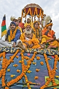 Large Group OF Holy Men On Roof Of Flower Decorated Jeep