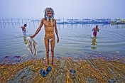 Elderly Brahmin Pilgrim Takes Dawn Dip At Sangam