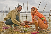 Pilgrim Couple Perform Private Ceremony Next To Ganges Sangam
