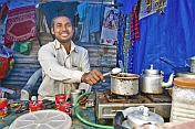 Tea Stall Owner Adds Sugar To Pan Of Boiling Indian Chai Tea