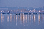 Rowing Boats Take Pilgrims To Ganges Yamuna Sangam Before Dawn