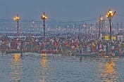 Mass Crowds Of Pilgrims Bathe At The Ganges Yamuna Sangam Before Dawn