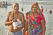 Elderly Indian Couple Pose After Sacred Dip In Ganges River