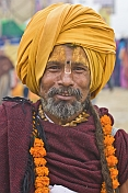 Smiling Hindu Holy Man With Orange Turban And Marigold Flower Garlands