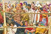 Villager Pilgrims Crowd Behind Barriers To See Basant Panchami Snana Procession