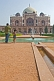 Image of Indian father with young daughter takes a photograph of Humayun's Tomb.
