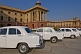 Image of White Ambassador cars waiting outside the Lutyens-designed North Block Secretariat.
