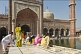 Image of Muslim women perform ablutions before going to pray at Shah Jahan's Jama Masjid mosque.