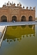 The front of the Jama Masjid is relected in the ablutions pool.
