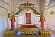 Image of Golden throne with painted statues at the Meherangarh Fort Palace Museum.