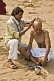 Image of A barber shaves a Pilgrims head with a traditional cut-throat razor, on the dried-up bed of the Phalgu River, near the Vishnupad Temple.