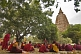 Image of Buddhist monks wait for services to begin next to the Mahabodhi Temple.
