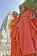 Image of Two novice Buddhist monks in front of the Mahabodhi Temple, where the Buddha achieved enlightenment.